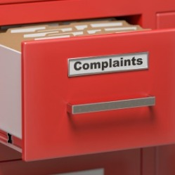 red file drawer with the word complaint