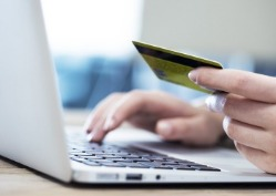 women shopping online with credit car in hand | Virtual Resort Manager